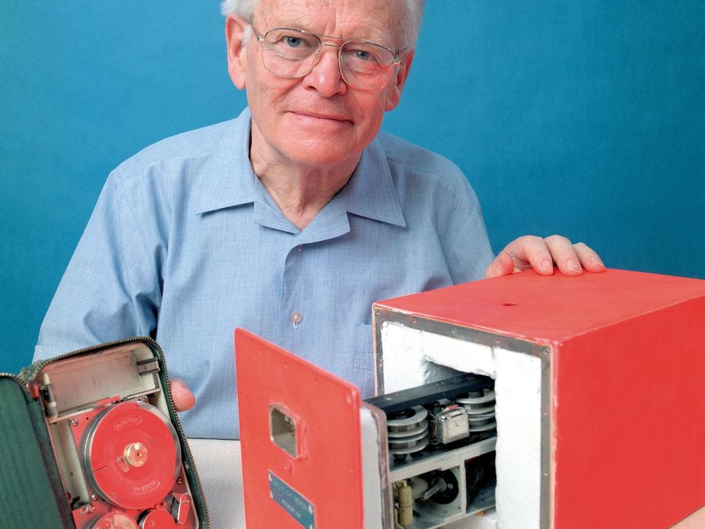 undated image provided by the Australian Defence Department, Australian scientist David Warren poses with his flight data recorder. Warren, who invented the 'black box' flight data recorder, has died, defense officials said Wednesday, July 21, 2010.