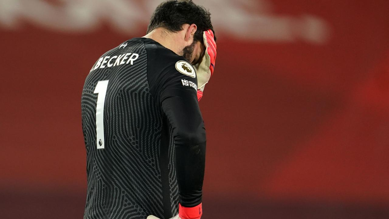 Liverpool's goalkeeper Alisson Becker reacts after conceding their third goal. (Photo by Jon Super / POOL / AFP)