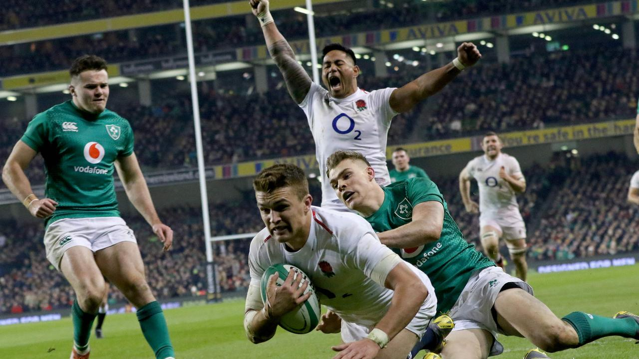 England centre Henry Slade dives over the line to score a try at the Aviva Stadium.