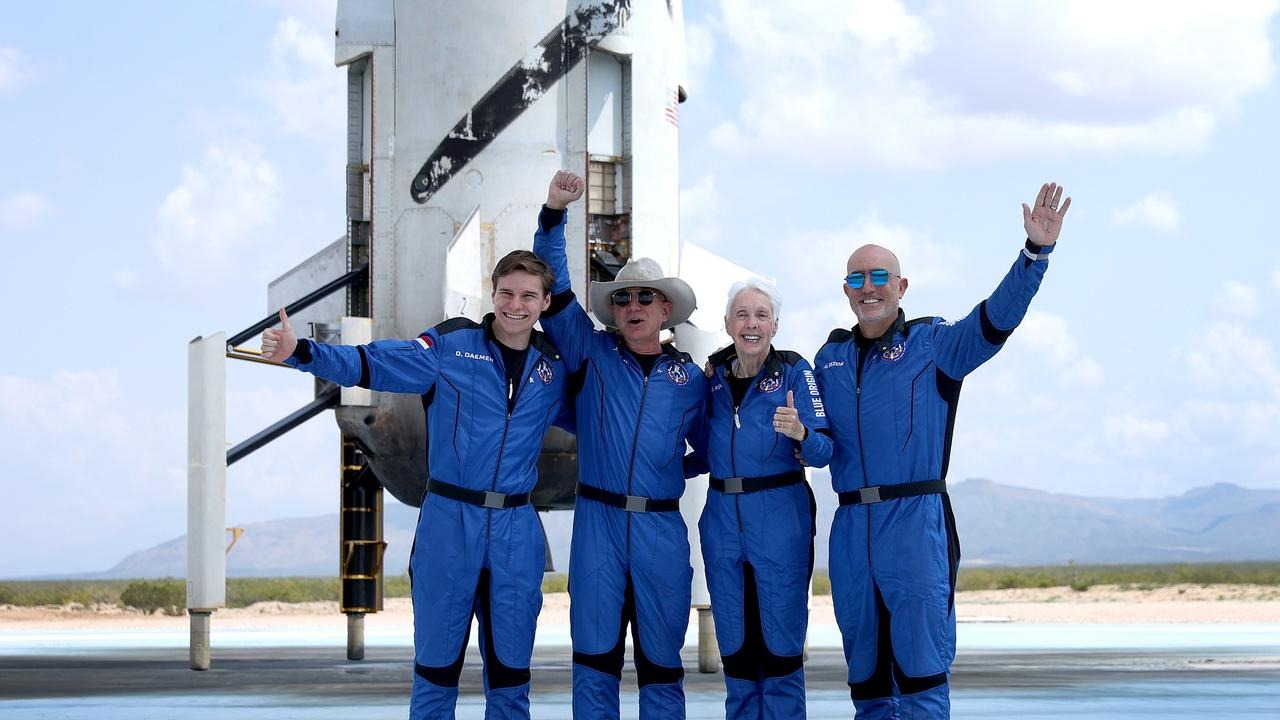 The New Shepard crew Oliver Daemen, Jeff Bezos, Wally Funk and Mark Bezos celebrate after returning to Earth after their visit to space. Picture: Getty Images/AFP