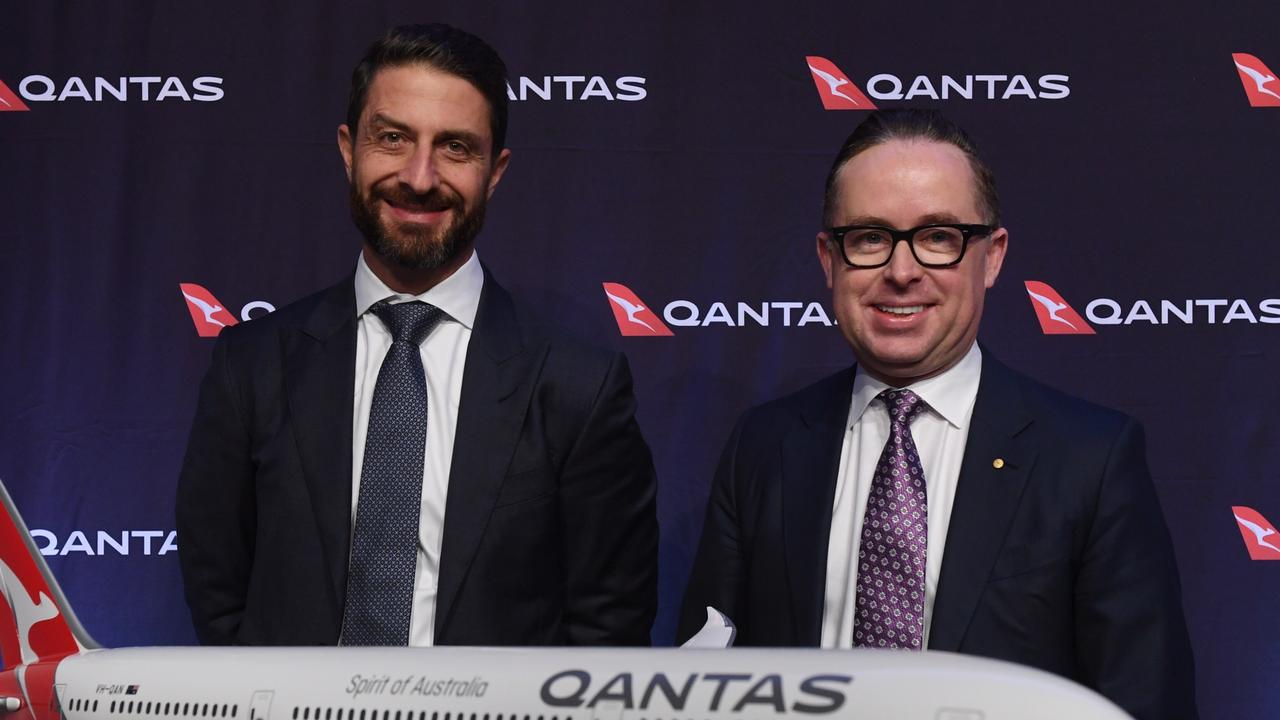 Qantas group chief executive Alan Joyce with Tino La Spina (left). Picture: Dean Lewins/AAP