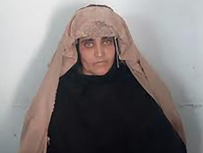Sharbat Gula, the 'Afghan Girl', awaits her court hearing in Peshawar. Picture: AFP/FIA