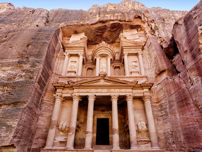92. PETRA, JORDAN Carved into pink sandstone in Jordan's Arabah valley, Petra (also known as the 'Rose City') was once the capital city of the ancient Nabataean dynasty. Access is via al-Siq — a tall narrow passage (providing handy shade from the harsh desert sun). The money shot is the 40m-tall Treasury whose facade still in great condition, bullet holes (from treasure-hunters) aside.