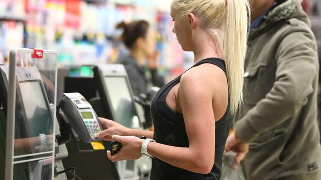 Shoppers at Woolworths, Centro, Surfers Paradise. Lorrae Conybear going through the self service checkout.