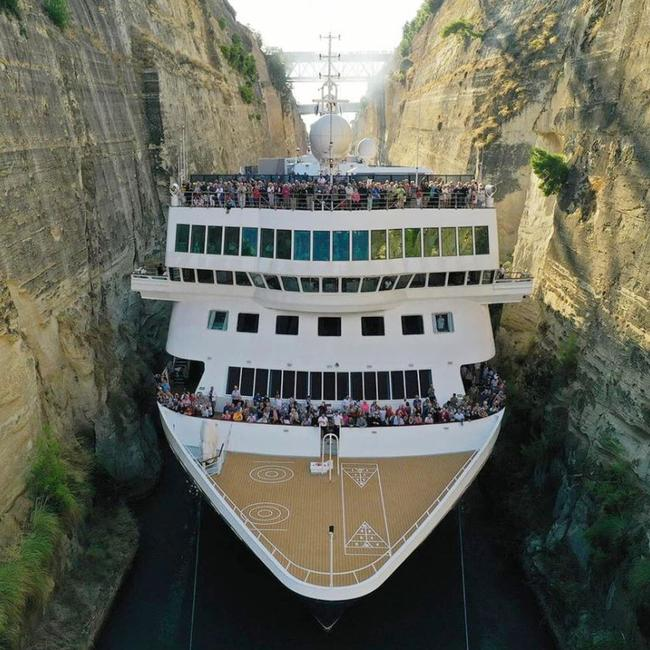 Massive cruise ship squeezes through tiny Greek canal