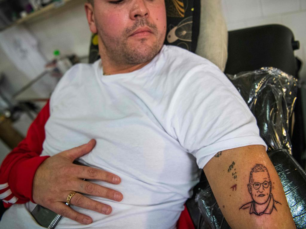 32-years-old Gustav Lloyd Agerblad has a tattoo of Tegnell on his arm. Picture: Jonathan NACKSTRAND / AFP