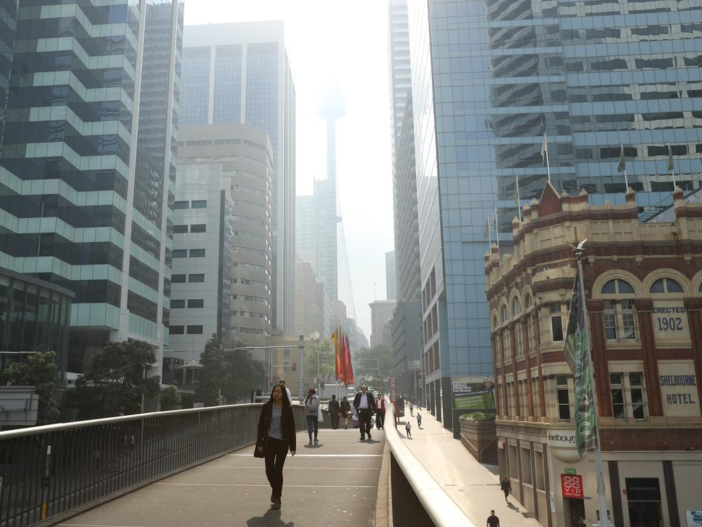 A haze of smoke from regional fires settles across the Sydney CBD. Picture: Rohan Kelly
