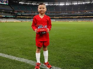 Jaguar Bogert, 6, was named Auskicker of the Week in round eight and will present a premiership medal to a player from the winning team on Grand Final Day. Picture: AFL Photos