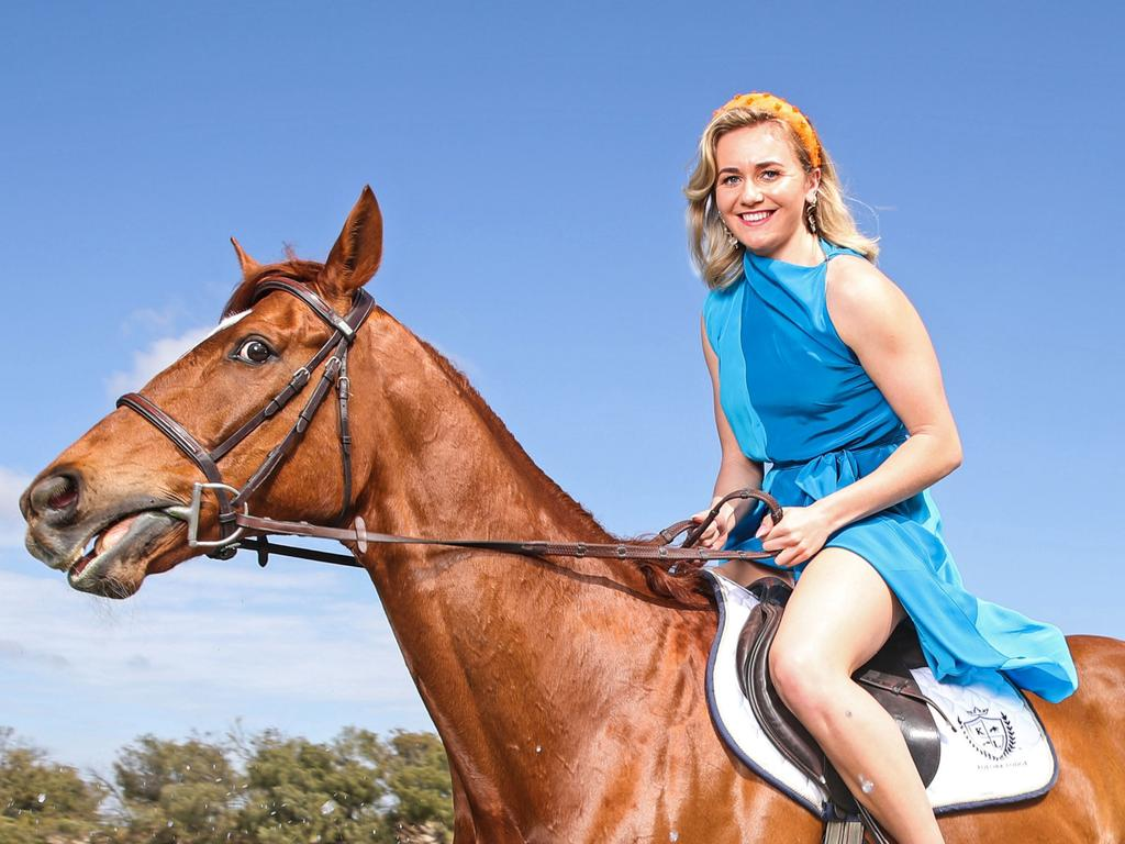 Tokyo Olympic games Gold Medallist Ariarne Titmus has been announced as the 2021 Melbourne Cup Day Ambassador. Ariarne is riding retired thoroughbred racehorse Immortalis at The Spit, Main Beach, Gold Coast. Ariarne is wearing racewear from sass & bide/Myer. Picture: Zac Simmonds