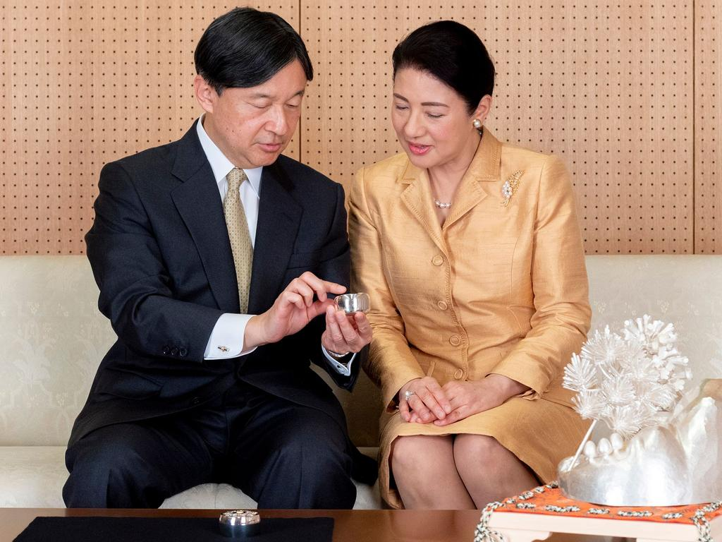This handout photo taken on December 3, 2019 and released by the Imperial Household Agency on December 9, 2019 shows Japan's Emperor Naruhito and Empress Masako speaking at their residence in Tokyo.