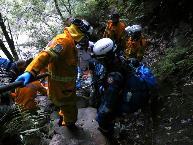 Rescuers had to carry Ms Cheng back up the steep valley. Picture: Tim Hunter.