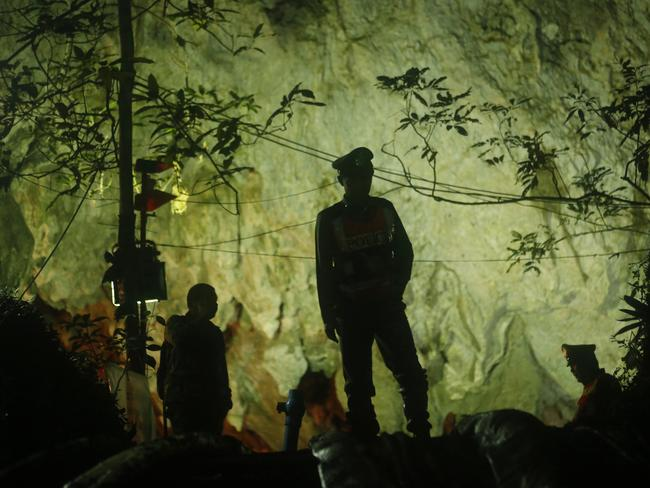 Thai police stand in front of the entrance to a cave complex where 12 boys and their soccer coach went missing more than a week ago. Picture: AP