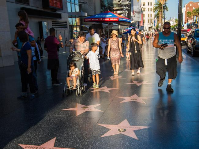WALK THE HOLLYWOOD WALK OF FAME The Hollywood Walk of Fame with its embedded brass stars from celebrities ranging from Audrey Hepburn to Snoop Dogg is easily the most iconic and interesting sidewalk in the city. But it's more than just its stars. The area's also home to wandering movie characters ready to pose with your kids for photos, as well as the famous TCL Chinese Theatre.