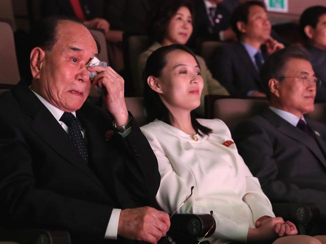 Kim Yong-nam wipes tears next to Mr Moon and Kim Yo-jong during a concert in Seoul by musicians from Pyongyang. Picture: AFP/YONHAP