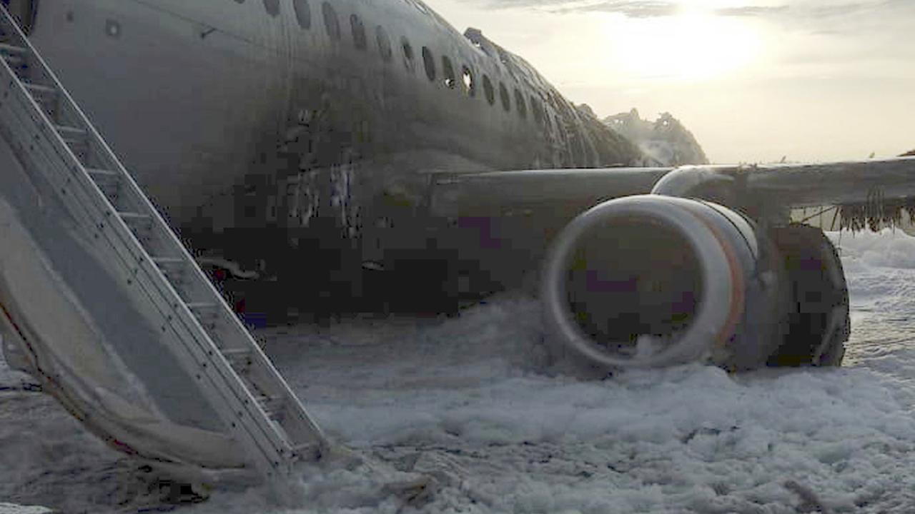 The Sukhoi Superjet 100 aircraft of Aeroflot Airlines is covered in fire retardant foam after an emergency landing in Sheremetyevo airport in Moscow, Russia. Picture: Moscow News Agency photo via AP.