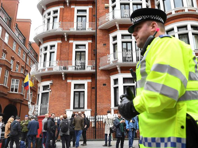 UK police have spent millions guarding the embassy with Metropolitan police officers now replaced by covert surveillance. Picture: AP PHOTO / Justin TALLIS