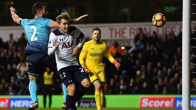 Tottenham Hotspur's Danish midfielder Christian Eriksen heads the ball to score.