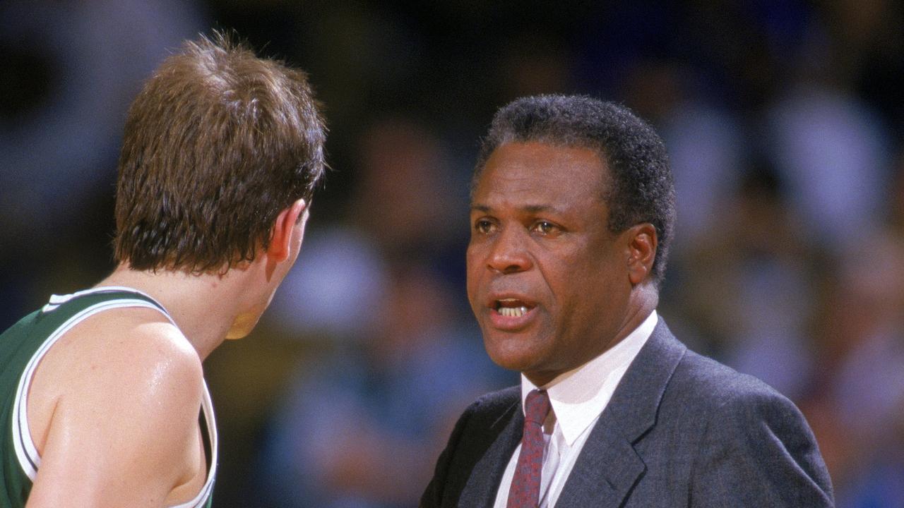 Danny Ainge #44 of the Boston Celtics listens to head coach K.C. Jones