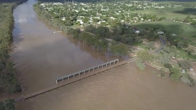 Floodwater Cuts Off Queensland Town, Submerges Bridge