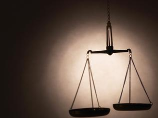 Silhouette of weight scales of justice.