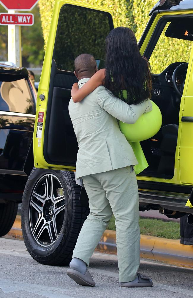 Kanye West also lifted Kim Kardashian out of their car when they arrived at the wedding. Picture: Mega