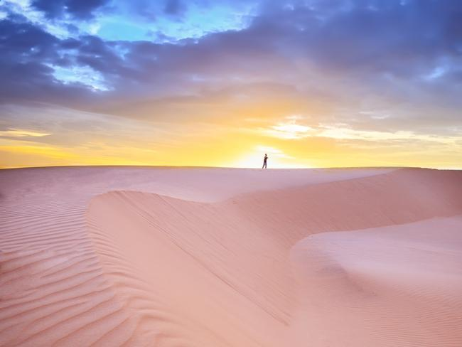 """... Known as the """"red dunes"""" and """"white dunes"""", for obvious reasons, they can be explored on foot, by hiring ATV dune buggy or sandboard or, as of last year, by taking a hot-air balloon ride above. They're at their most stunning - and you'll avoid the midday heat - at sunrise and sunset."""