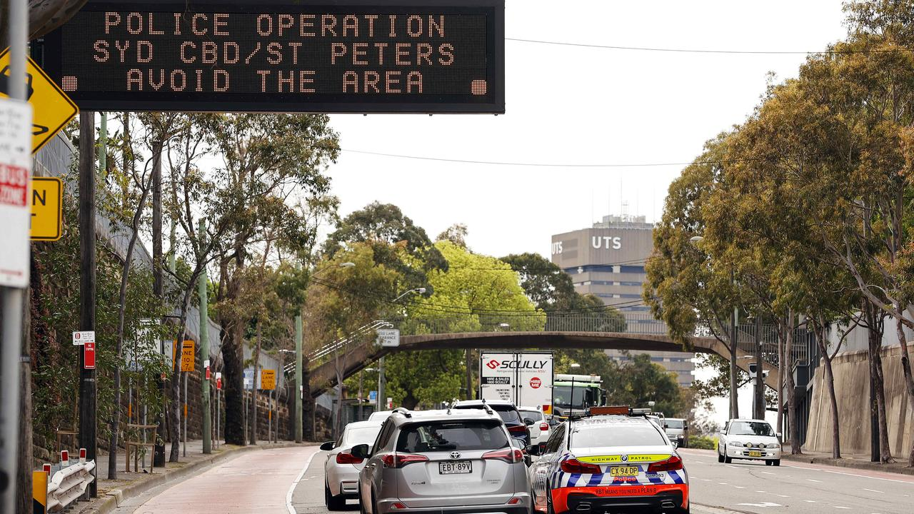Glebe motorists warned about the mass rally being planned and the police operation in place. Picture: Tim Hunter.