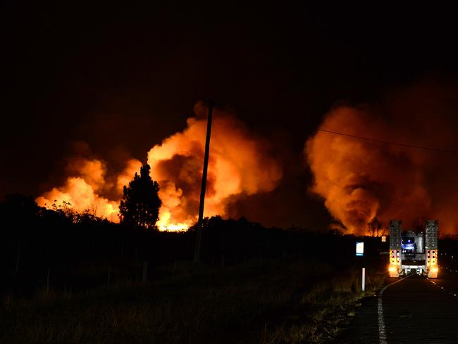 The flames lit up the billowing smoke dramatically at night. Picture: Karl Hofman