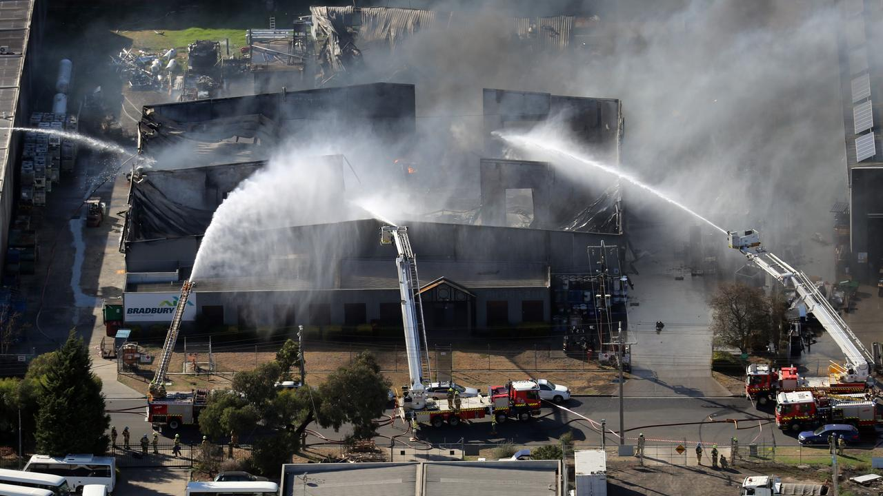 Firefighters put in a mammoth effort battling the factory fire. Picture: Alex Coppel