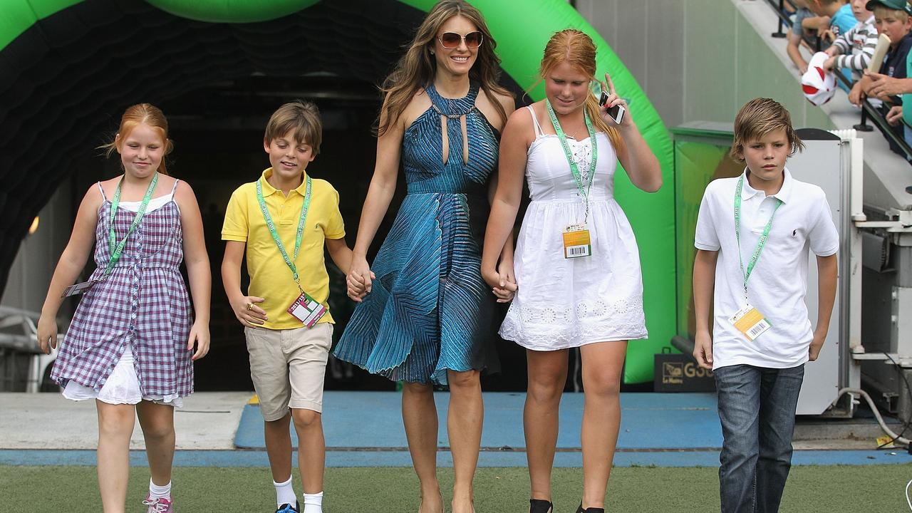 Liz Hurley with her son Damian (yellow) and Shane Warne's children Brooke, Summer (left) and Jackson at the MCG in 2011. Picture: Getty