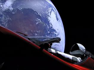 "TOPSHOT - This still image taken from a SpaceX livestream video shows ""Starman"" sitting in SpaceX CEO Elon Musk's cherry red Tesla roadster after the Falcon Heavy rocket delivered it into orbit around the Earth on February 6, 2018. Screams and cheers erupted at Cape Canaveral, Florida as the massive rocket fired its 27 engines and rumbled into the blue sky over the same NASA launchpad that served as a base for the US missions to Moon four decades ago. / AFP PHOTO / SPACEX / HO / RESTRICTED TO EDITORIAL USE - MANDATORY CREDIT ""AFP PHOTO / SPACEX"" - NO MARKETING NO ADVERTISING CAMPAIGNS - DISTRIBUTED AS A SERVICE TO CLIENTS"