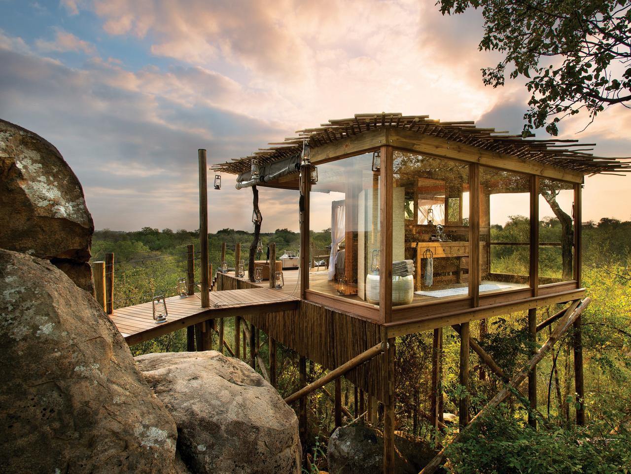 ESCAPE: SAFARI TREE HOUSES .. Tony Park story .. The Kingston tree house is built into a pile of granite boulders, with a commanding view of the African bush. Picture: supplied by Lion Sands.