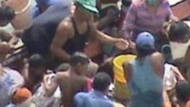 Starving Venezuelans plunder a fishing boat's catch. Picture: Twitter/@AbogadoAntonioV