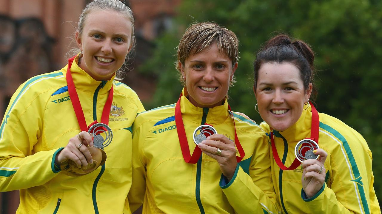 GLASGOW, SCOTLAND - JULY 31: Kelsey Cotterell, Karen Murphy and Lynsey Clarke of Australia pose with their silver medals won in the women's triples final match between England and Australia at Kelvingrove Lawn Bowls Centre during day eight of the Glasgow 2014 Commonwealth Games on July 31, 2014 in Glasgow, United Kingdom. (Photo by Mark Kolbe/Getty Images)
