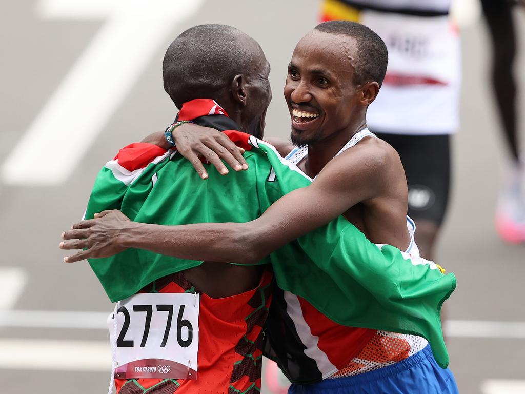 Kipchoge and Nageeye embrace at the finish line.