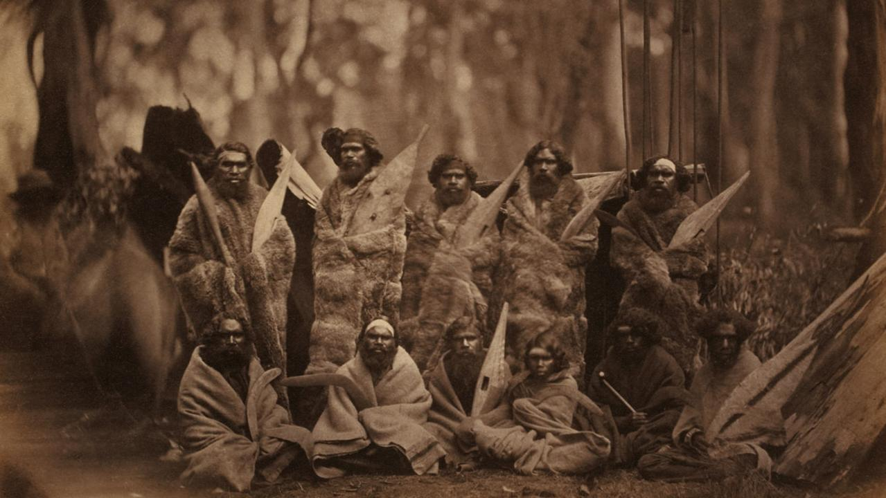Image of the Kulin people photographed in Melbourne in the late 1850s, wearing the distinguishing cloaks of possum skin, which were worn throughout the southeast and usually inscribed on the inside skin with particular clan designs, from book 'First Australians: An Illustrated History' edited by Rachel Perkins.