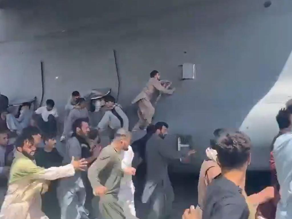 Footage shows what appears to be young Afghan men attempting to stowaway.