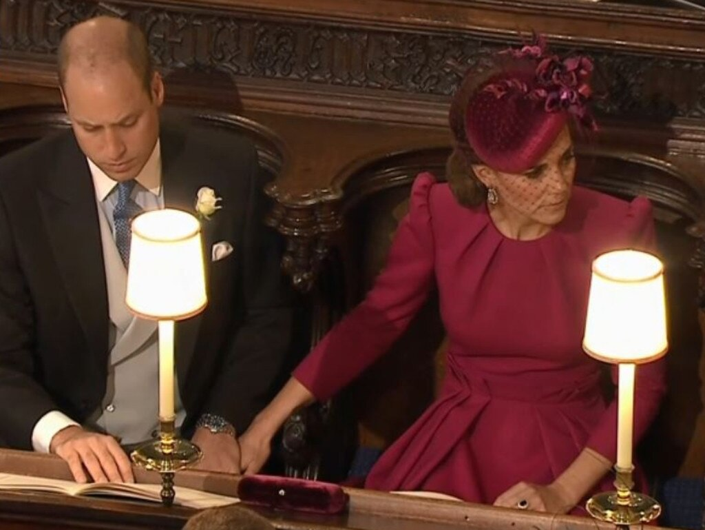 Kate and William holding hands at Princess Eugenie's wedding.