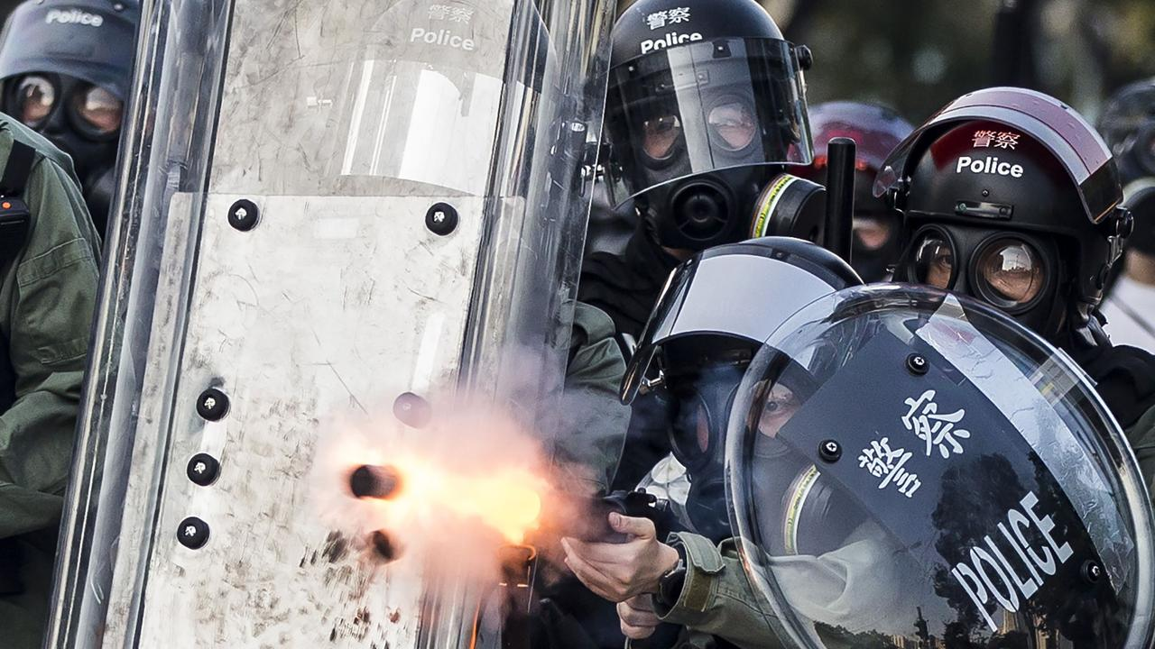 Riot police fire projectiles against protesters. Photo: Isaac Lawrence/AFP
