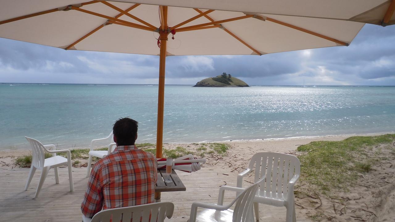 LORD HOWE ISLAND .. for Ceridwen Dovey story .. Gazing at Blackburn Island across the lagoon from Pinetrees Lodge's casual sundowner spot, 'The Boatshed'