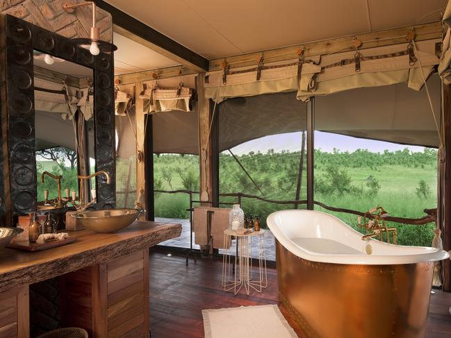 SOMALISA CAMP, HWANGE NATIONAL PARK, ZIMBABWE: Forget the awkward dash to the shower block. The tents at Somalisa Camp are each equipped with a copper bathtub providing views of the Hwange National Park savanna. With huge elephant herds, the area is known as the land of the giants, but it's the little luxuries that set this camp apart. If it gets a little chilly at night, there's a fireplace to keep you warm. And during the day, guests can cool off in a splash pool overlooking the waterhole that attracts herds of animals.