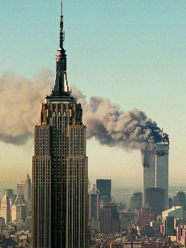 The twin towers of the Twin Towers burn behind the Empire State Building. Picture: AP