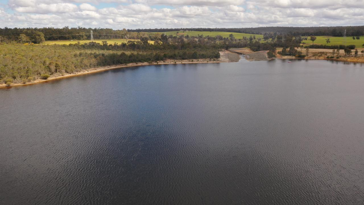 AFTER: There is no sign that the man-made Lake Kepwari, near Collie in southwest Western Australia, used to be the Yancoal-operated Premier Coal mine pit, above