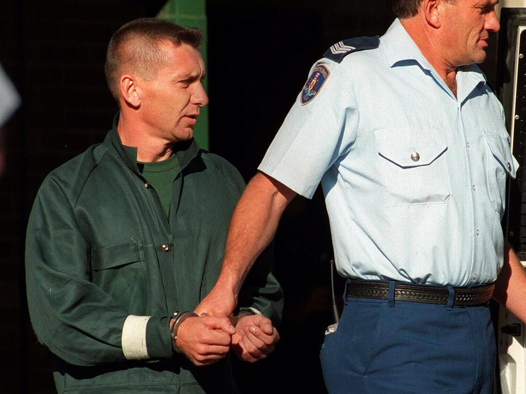 Anita Cobby murderer John Travers being led from Bowral Police Station in 1996 after an attempted escape.