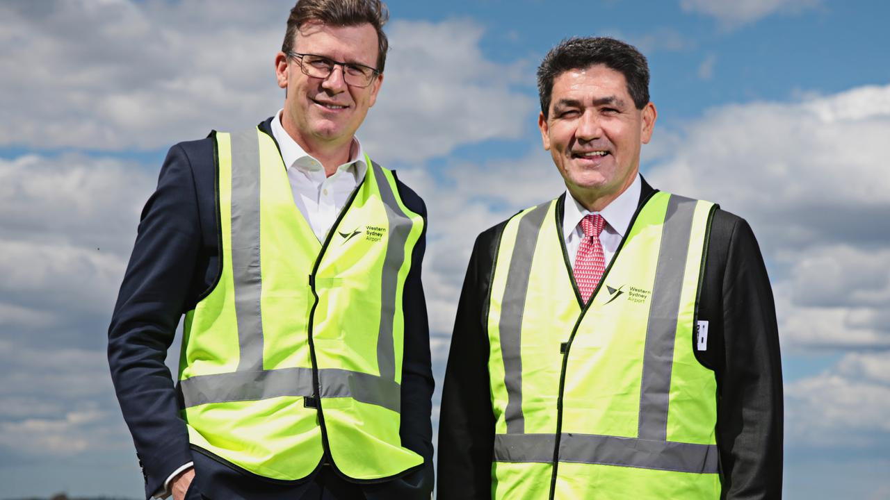 Federal MP Alan Tudge (left) and NSW MP Geoff Lee at Badgerys Creek airport in Sydney. Mr Tudge has said Sydney is well ahead of Melbourne on new road and rail projects. Picture: Adam Yip