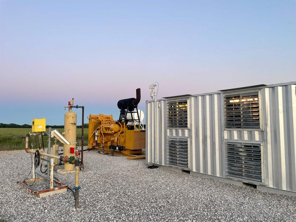"""A natural gas generator powering a bitcoin mining data centre on an oilfield in North Texas. (Photo by Matt Lohstroh / AFP) / RESTRICTED TO EDITORIAL USE – MANDATORY CREDIT """"AFP PHOTO"""