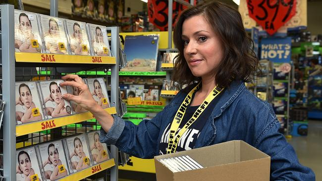 Stocking up: Tina Arena places copies of new album Eleven on JB HiFi shelves. Picture: Ellen Smith