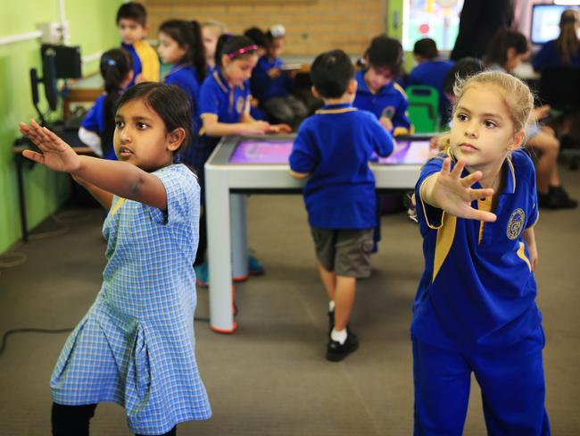 Ashly Chariyekkara and Elyssa Bassily play on the X-Box in an area called The Hub. Picture: Toby Zerna