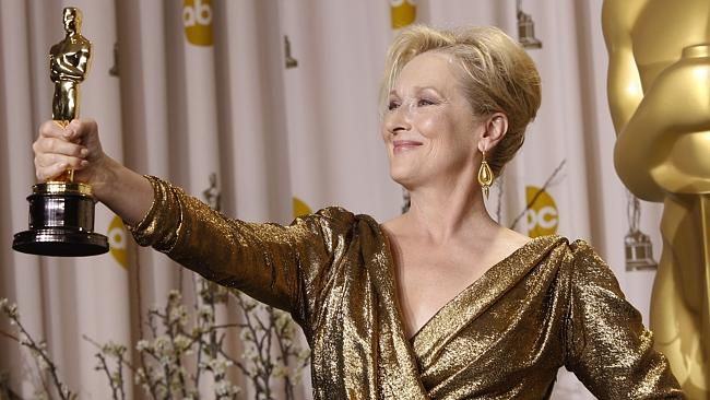 Meryl Streep poses with her Oscar for Best Actress for 'The Iron Lady' during the 84th Academy Awards in Los Angeles, Califor...