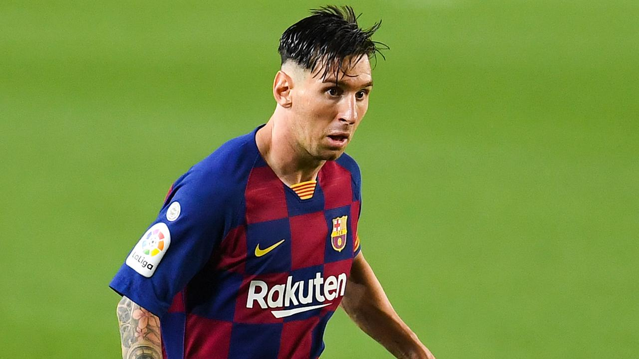 Lionel Messi scored his 700th career goal while sporting a questionable haircut. (Photo by David Ramos/Getty Images)